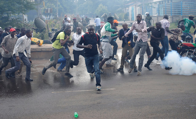 Protesters run away from the police during clashes in Nairobi, Kenya May 16, 2016. (Photo by Goran Tomasevic/Reuters)