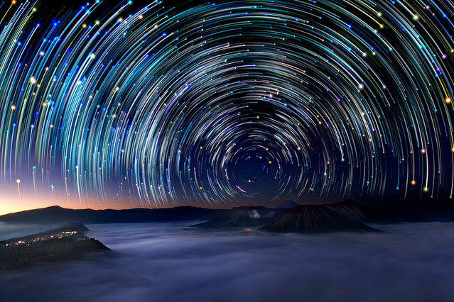 Star trails photographed by Justin Ng from Mount Bromo in East Java, Indonesia. These astonishing images of night sky are captured by Singapore based photographer Justin Ng. The pictures were taken between November 2013 to January 2014. It show's star trail caused by the earth's rotation and also can be achieved by zooming the DSLR lens inward or outward in small steps using a dedicated motorized zooming device. (Photo by  Justin Ng/Barcroft Media)