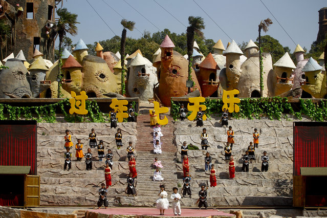 """""""Dwarf Empire"""" cast members perform at the Dwarf Empire theme park outside Kunming, China's Yunnan province, 04 April 2013. (Photo by Diego Azubel/EPA)"""