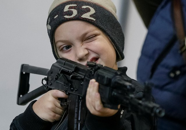 """A visitor attends the annual exhibition of weaponry and military equipment """"Arms and Security"""" in Kiev, Ukraine on October 8, 2019. (Photo by Gleb Garanich/Reuters)"""