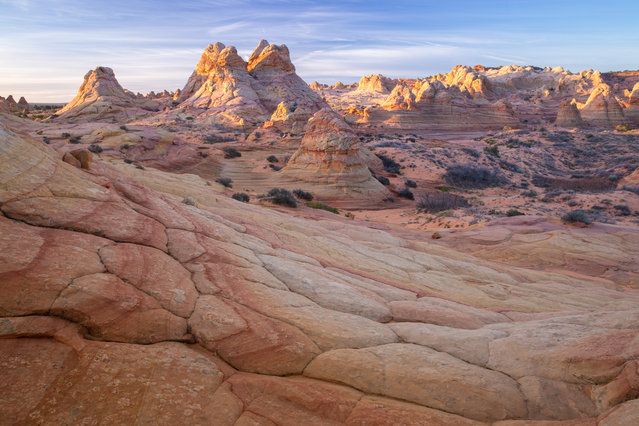 Sunrise over the landscape at Coyote Buttes South in Kanab, Utah. (Photo by David Clapp/Barcroft Images)