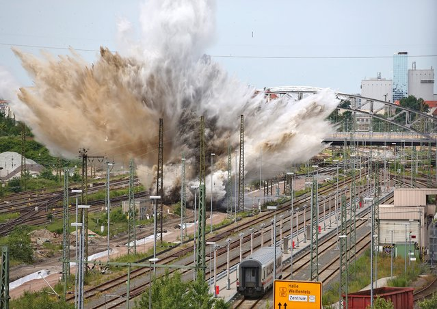 An aerial bomb is detonated in a railway area in Leipzig, Germany, 12 June 2014. Experts of the bomb disposal team demolished the bomb, after the American aircraft bomb was discovered during construction works at the old post station. (Photo by Jan Woitas/EPA)
