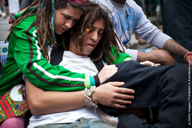 An Occupy Wall Street protester is consoled while crying in Union Square at the end of a march from Zuccotti Park to Union Square