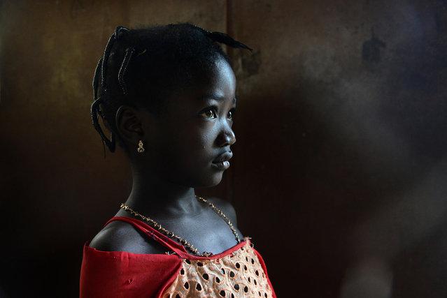 """""""Bambina Somba"""". Togo in un villaggio nella foresta in una capanna adibita a scuola ho incontrato questa splendida bambina di etnia Somba che non ho esitato di fotografarla nella stessa capanna. Photo location:  Togo, West Africa. (Photo and caption by Salvatore Valente/National Geographic Photo Contest)"""