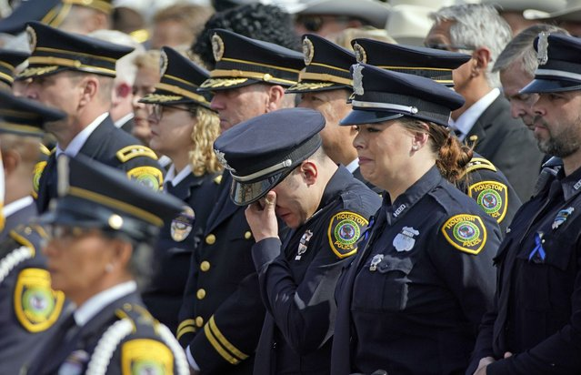 A Houston Police Officer wipes away tears during a funeral service for Houston Police Sgt. Christopher Brewster, Thursday, December 12, 2019, at Grace Church Houston in Houston. Brewster, 32, was gunned down Saturday evening, Dec. 7, while responding to a domestic violence call in Magnolia Park. Police arrested 25-year-old Arturo Solis that night in the shooting death. Solis faces capital murder charges. (Photo by David J. Phillip/AP Photo)
