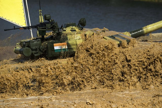 An Indian tank pushes through the water during competition in Alabino, outside Moscow, Russia, Monday, August 3, 2015. (Photo by Pavel Golovkin/AP Photo)