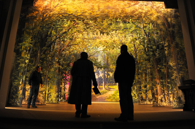 In this photo taken December 22, 2014, from left, Bert Bouma, Mark Viergutz and Kal Poole examine the backdrops at the Consistory Shrine Temple in Helena, Mont. (Photo by Thom Bridge/The Independent Record via AP Photo)