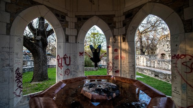 A man practices parkour tricks at the medieval ruins of Margaret Island in Budapest, Hungary, 30 March 2017. Practitioners' aim to get from one point to another in a complex environment, without assistive equipment and in the fastest and most efficient way possible. (Photo by Zsolt Szigetvary/EPA)