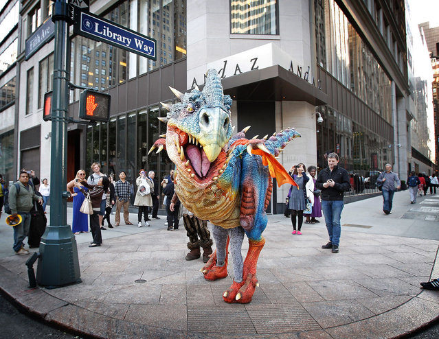 "The Baby Nager dragon, from DreamWorks' new ""How to Train Your Dragon"" Live Spectacular touring musical, shows off it's colors outside of the New York Public Library"