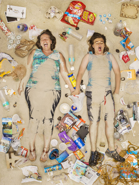 Tammy and Trevor surrounded by seven days of their own rubbish in Pasadena, California. If you've never thought about how much rubbish you throw away an honest photographic series will open your eyes. (Photo by Gregg Segal/Barcroft Media)