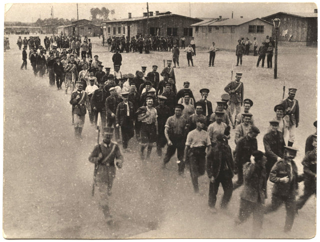 German soldiers escort French soldiers at a prisoner of war camp. (Photo by Dr. P.A. Smithe/National World War I Museum, Kansas City, Mo.)