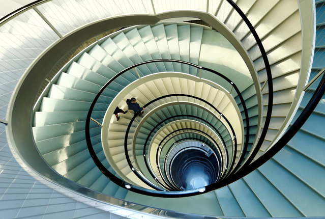 Employees walk down the stairs in the headquarters of world food giant Nestle in Vevey, Switzerland, October 20, 2016. (Photo by Denis Balibouse/Reuters)
