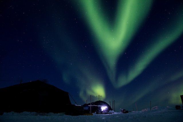 The aurora borealis displays above Ice Camp Skate, Beaufort Sea on March 9, 2018 during Ice Exercise (ICEX) 2018. ICEX 2018 is a five-week exercise that allows the Navy to assess its operational readiness in the Arctic, increase experience in the region, advance understanding of the Arctic environment, and continue to develop relationships with other services, allies and partner organizations. (Photo by U.S. Navy photo by Mass Communication 2nd Class Micheal H. Lee/U.S. Navy)