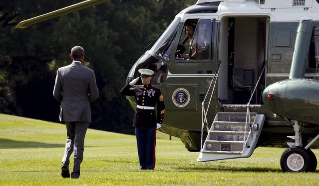 U.S. President Barack Obama walks toward Marine One as he departs the White House in Washington August 27, 2015. (Photo by Kevin Lamarque/Reuters)
