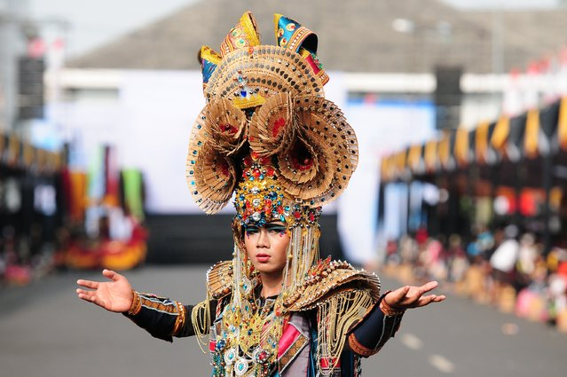 A model wears a Tambora costume in the kids carnival during The 13th Jember Fashion Carnival 2014 on August 21, 2014 in Jember, Indonesia. (Photo by Robertus Pudyanto/Getty Images)