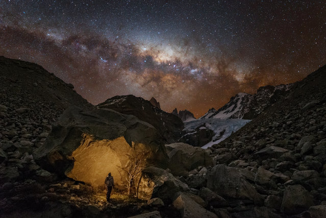 """People and Space"". Winner: Wanderer in Patagonia by Yuri Zvezdny (Russia) A lone stargazer stares up at the stars of our galaxy, the Milky Way, as they stretch across the night sky over the glacier ""White Stones"" (Piedras Blancas) in the Los Glaciares National Park, Argentina. El Chaltén, Santa Cruz Province, Argentina, 27 September 2016 iOptron Sky-Tracker mount, Sony A7S camera, 18 mm f/2.8 lens, ISO 5000, 30-second exposure Wanderer in Patagonia. (Photo by Yuri Zvezdny/Insight Astronomy Photographer of the Year 2017)"