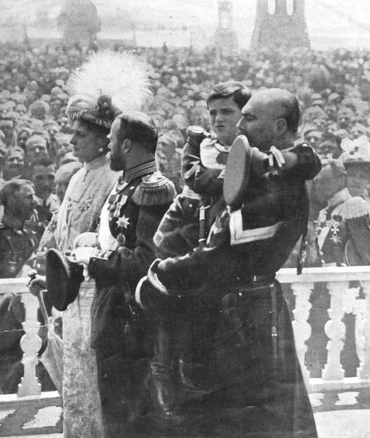 The last Tsar of Russia Nicholas II (centre) with his wife Tsarina Alexandra and their son Alexis (being held by a Cossack) during celebrations at the Kremlin to mark the Romanov family's 300 years in power, 1913. (Photo by Henry Guttmann)