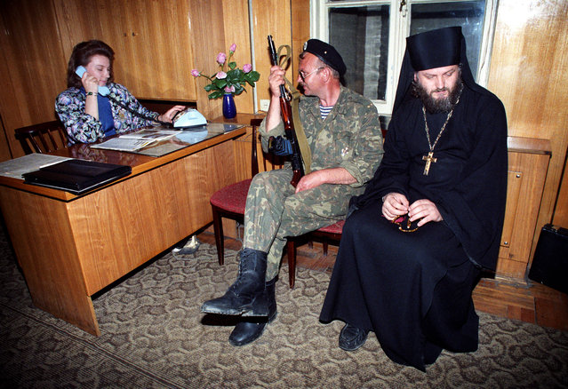 Gadauta, Abkhazia, 1993. A militiaman and a priest waiting in the outer office of the Press Center of Abkhazia. (Photo by Vladimir Gurin/ITAR-TASS)