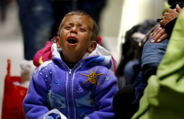 An exhausted Syrian boy cries after he arrived with his family on a train from Budapest's Keleti station at the railway station of the airport in Frankfurt, Germany, early morning September 6, 2015. (Photo by Kai Pfaffenbach/Reuters)