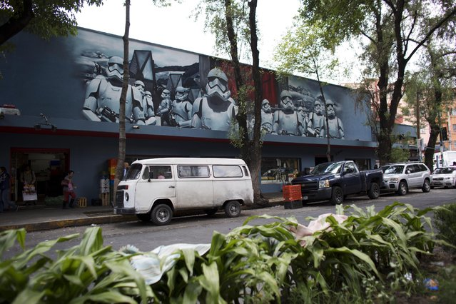 In this September 1, 2015 photo, storm troopers painted by Street Art Chilango member artist Andrik Figueroa Barreto, also known as Andrik Noble, adorns the Michoacan Market in the Condesa neighborhood of Mexico City. After a virtual map of the murals on streetartchilango.com began attracting attention to the art, the co-op began organizing walking tours on weekends. (Photo by Rebecca Blackwell/AP Photo)
