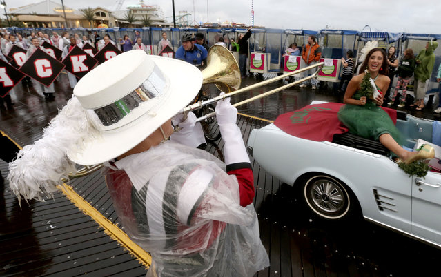 A member of the Jackson Memorial High School band, left, of Jackson, N.J., serenades Miss Vermont Lucy Edwards during the Miss America Shoe Parade at the Atlantic City boardwalk, Saturday, September 13, 2014, in Atlantic City, N.J. (Photo by Julio Cortez/AP Photo)