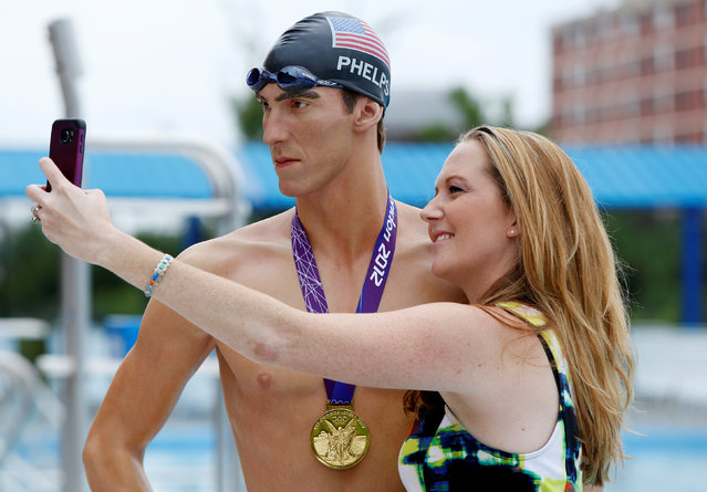 Lauren Cottrell takes a selfie next to a Madame Tussauds Museum figure of U.S. Olympic gold medal swimmer Michael Phelps at Banneker Pool in Washington, U.S., to coincide with the opening of the Rio Olympics August 5, 2016. (Photo by Gary Cameron/Reuters)