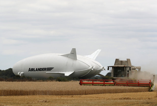The Airlander 10 hybrid airship undergoes checks before its maiden flight at Cardington Airfield in Britain, August 14, 2016. (Photo by Darren Staples/Reuters)