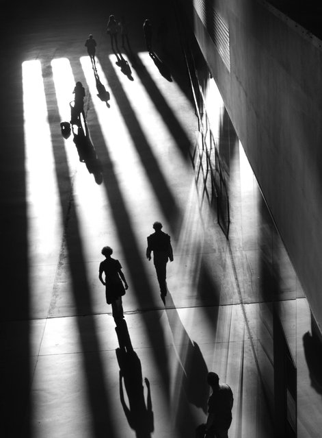 """""""A game of shadows"""". I took this picture in London (Tate modern). Was a game between lights and shadows where everyone played a role. Photo location: London, UK. (Photo and caption by Ignace Benjamin/National Geographic Photo Contest)"""