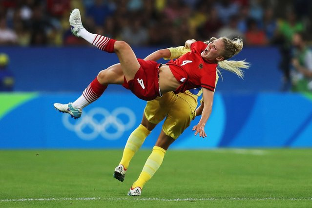 Leonie Maier (in red) of Germany is challenged by Elin Rubensson of Sweden during the women's Olympic gold medal game, August 19, 2016. (Photo by Buda Mendes/Getty Images)
