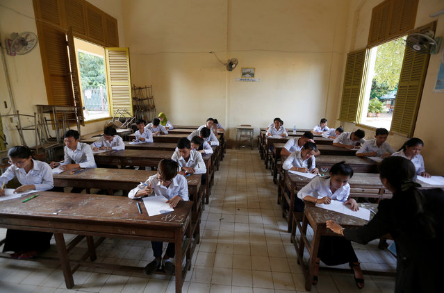 Students sit for the final examinations at the Sisowath High School in central Phnom Penh, Cambodia, August 22, 2016. (Photo by Samrang Pring/Reuters)