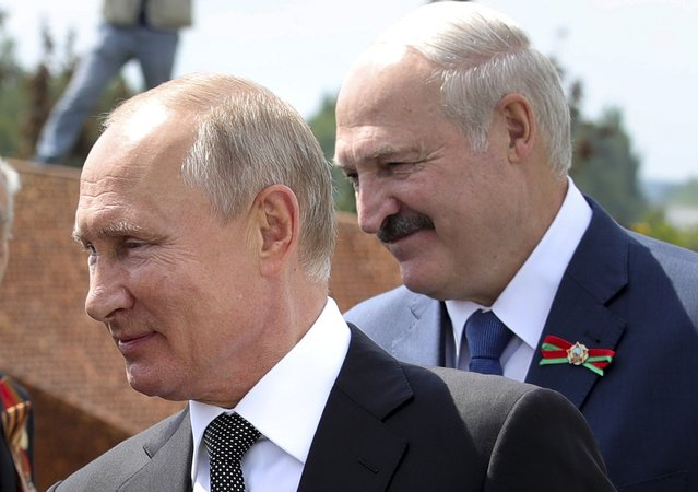Russian President Vladimir Putin, left, and Belarusian President Alexander Lukashenko greet a group WWII veterans during an opening ceremony of the monument in honour of the World War II Red Army, in the village of Khoroshevo, just outside Rzhev, about 200 kilometers (about 125 miles) northwest of Moscow, Russia, Tuesday, June 30, 2020. (Photo by Mikhail Klimentyev, Sputnik, Kremlin Pool Photo via AP Photo)
