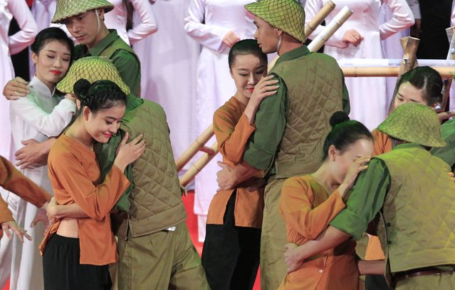 Performers depict a scene of the reunion moment between soldiers and women 60 years ago, during the 60th anniversary of the Hanoi Liberation Day celebrations in Hanoi October 10, 2014. Hanoi celebrates the 60th anniversary of its liberation day on October 10. (Photo by Reuters/Kham)