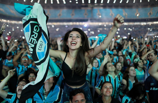 Gremio fans celebrate after their team won the Copa Libertadores final match at the Arena do Gremio in Porto Alegre, Brazil on November 29, 2017. (Photo by Diego Vara/Reuters)