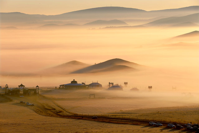 """Grassland Fog"". This photo was taken in September 2014 while travelling to Inner Mongolia. I was very lucky to see this unusual Advection fog in one early morning. I was told this only happen few times a year. Photo location: Inner Mongolia, China. (Photo and caption by Libby Zhang/National Geographic Photo Contest)"