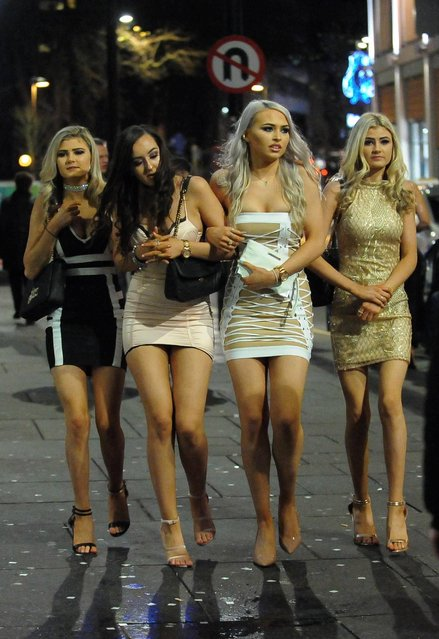 Revellers up and down the country celebrated the New Year in typical boozy style – including these ladies in Newcastle, England on December 31, 2017. (Photo by Will Walker/North News and Pictures)