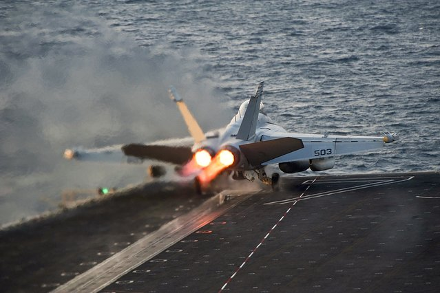 An EA-18G Growler launches from the Nimitz-class aircraft carrier USS Carl Vinson (CVN 70) in this U.S. Navy picture taken in the Arabian Gulf October 28, 2014. The United States targeted Islamic State militants on Sunday and Monday with five air strikes in Syria and nine in Iraq, according to U.S. Central Command. (Photo by Mass Communication Specialist 2nd Class John Philip Wagner Jr./Reuters/U.S. Navy)