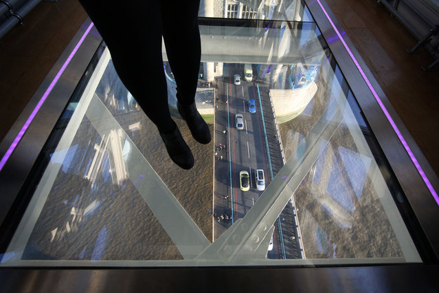 A visitor crosses Tower Bridge's new glass walkway on November 10, 2014 in London, England. (Photo by Peter Macdiarmid/Getty Images)