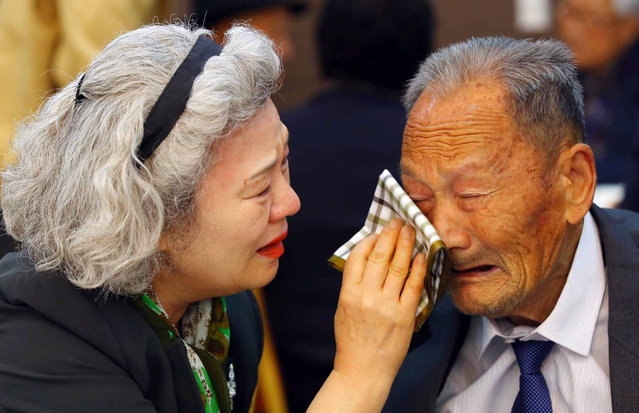South Korean Lee Jung-sook (L), 68, wipes the tears from her North Korean father Lee Heung-jong, 88, as they bid each other a sad farewell at a resort on Mount Kumgang, North Korea, 22 October 2015. About 390 South Koreans arrived at the resort two days ago for the first face-to-face reunion of families separated by the 1950-53 Korean War in nearly 20 months. A second group of some 260 South Koreans will do the same for three days starting on 24 October. (Photo by Yonhap/EPA)