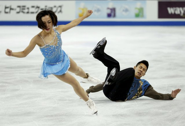 Sui Wenjing of China has her skating partner and compatriot Han Cong fall as they perform during the pairs free skate program at the Skate America figure skating competition in Milwaukee, Wisconsin October 24, 2015. (Photo by Lucy Nicholson/Reuters)