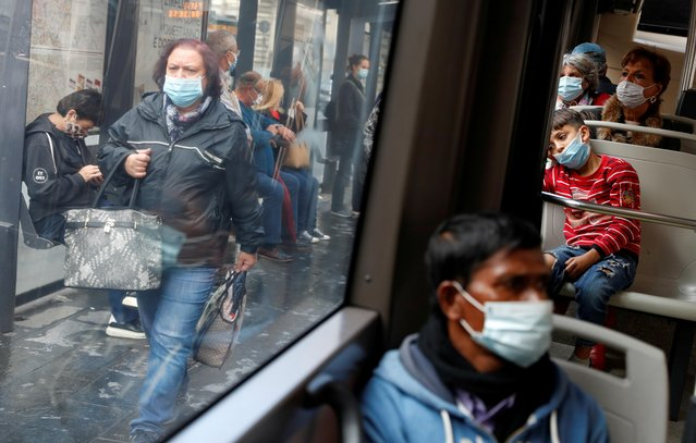 Passengers wearing protective face masks travel on a bus, as Italy adopts new restrictions aimed at curbing a surge in the coronavirus disease (COVID-19) infections, in Rome, Italy on October 15, 2020. (Photo by Yara Nardi/Reuters)