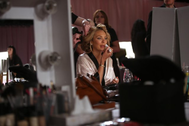 Model Candice Swanepoel is made up backstage at the Victoria's Secret fashion show in London, Tuesday, December 2, 2014. (Photo by Joel Ryan/Invision/AP Photo)
