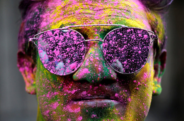 A man smeared in coloured powder poses during Holi celebrations in Kolkata, India, March 1, 2018. (Photo by Rupak De Chowdhuri/Reuters)