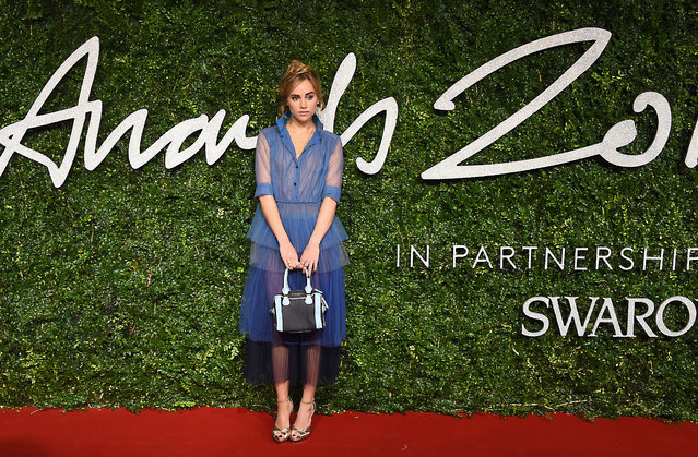 Model Suki Waterhouse poses for photographers upon arrival at The British Fashion Awards 2014, in London, Monday, December 1, 2014. (Photo by Jonathan Short/Invision/AP Photo)