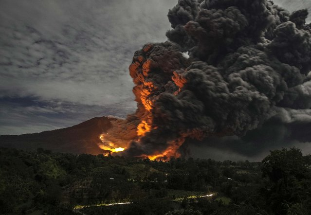 Mount Sinabung volcano erupts, as seen from Tiga Pancur village, Karo Regency in Indonesia's North Sumatra province, in this October 8, 2014 file photo. (Photo by Y. T. Haryono/Reuters)