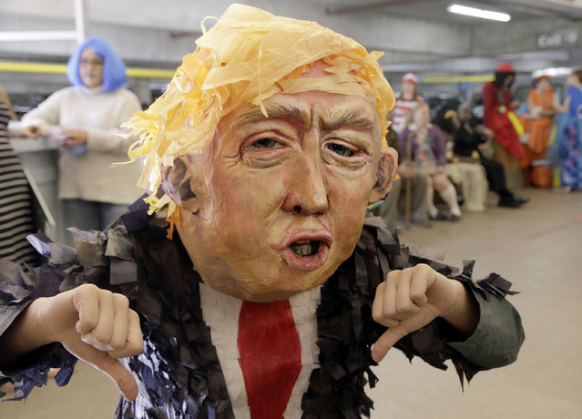 """Alia Yusuf wears a """"Donald Trump"""" mask before the taping of a Halloween themed television show at Warner Bros. Studio in Burbank, Calif., on Thursday, October 29, 2015. (Photo by Nick Ut/AP Photo)"""