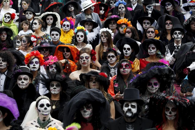 "People with their faces painted to look like the popular Mexican figure called ""Catrina"" take part in the annual Catrina Fest in Mexico City November 1, 2015. According to participants, about 310 women gathered at the Catrina Fest, where women dressed to look like ""Catrina"", a character also known as ""The Elegant Death"", created by Guadalupe Posada in the early 1900s. Mexicans celebrate the annual Day of the Dead on November 1 and 2. (Photo by Carlos Jasso/Reuters)"