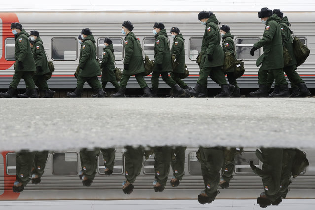Conscripts are seen during a ceremony at the Novosibirsk-Glavny railway station marking their departure for military service with the Russian Army, during the COVID-19 pandemic in Novosibirsk, Russia on November 6, 2020. (Photo by Kirill Kukhmar/TASS)