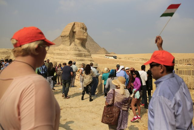 Tourists visit the Sphinx at the Giza Pyramids on the outskirts of Cairo, Egypt, November 8, 2015. (Photo by Amr Abdallah Dalsh/Reuters)
