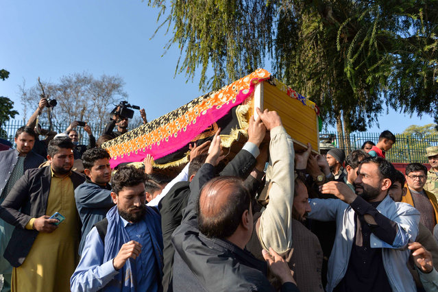 Mourners carry the coffin of female news anchor Malalai Maiwand, who was shot dead by gunmen in Jalalabad on December 10, 2020. (Photo by Noorullah Shirzada/AFP Photo)