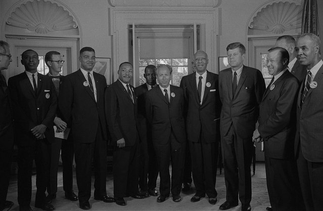 Civil rights leaders meeting with President John F. Kennedy in the Oval Office of the White House following the civil rights march on Washington D.C., August 28, 1963. Pictured are (left to right) Secretary of Labor Willard Wirtz, Congress of Racial Equality leader Floyd McKissick, National Catholic Conference for Interracial Justice leader Mathew Ahmann, National Urban League executive director Whitney Young, Southern Christian Leadership Conference leader Martin Luther King Jr. (Photo by Reuters/Library of Congress)